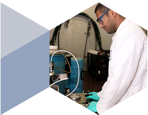Regis Technologies Scientist Evaluating Analytical Data In Expediting CGMP Scale Up Discovery To Market
