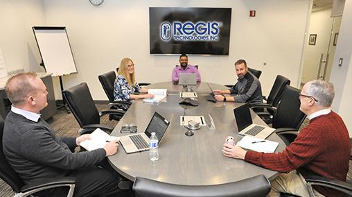 Regis People around table